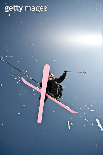Teenage skier high in air with sun. - gettyimageskorea