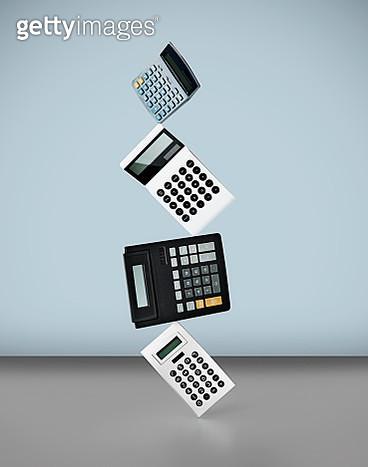 Stack of calculators - gettyimageskorea