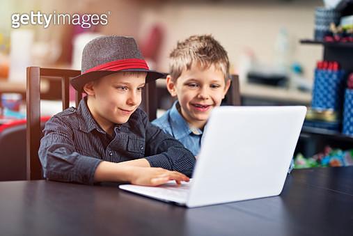 Happy little boys using laptop - gettyimageskorea