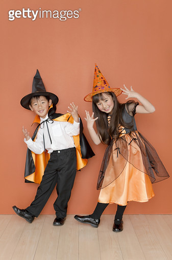 Boy and girl dressed for halloween - gettyimageskorea