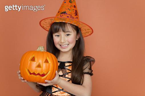 Girl with a halloween pumpkin - gettyimageskorea