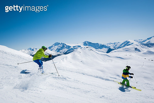 Father and Son Skiing - gettyimageskorea