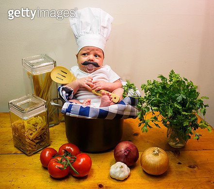Baby dressed up as a chef for Halloween - gettyimageskorea