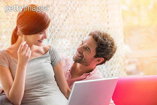 Couple making purchase online with credit card - gettyimageskorea