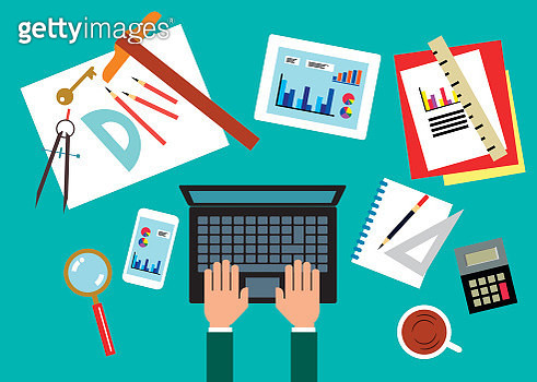 Overhead view of designer working on laptop surrounded by data and design tools - gettyimageskorea