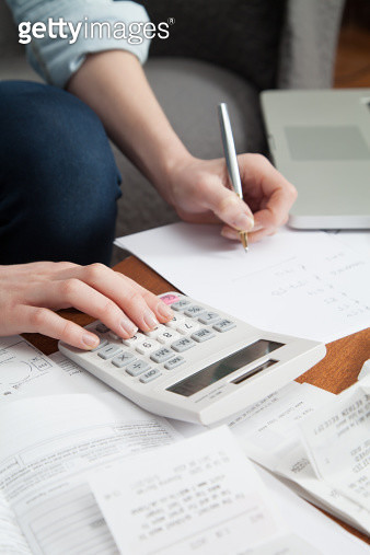 Young woman working on home finances - gettyimageskorea
