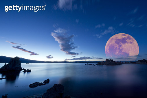 Moon over rock formation at Mono Lake, California, United States - gettyimageskorea