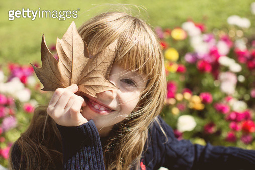 Girl with a leaf - gettyimageskorea