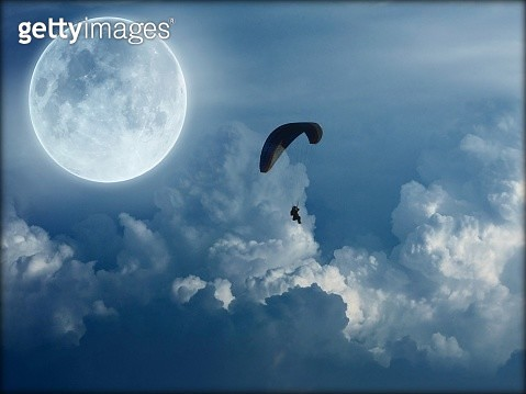 Silhouette Person Paragliding Against Sky - gettyimageskorea