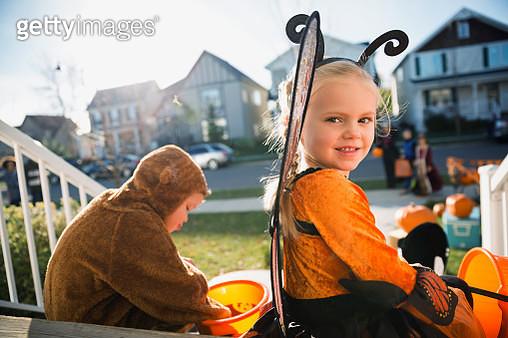 Portrait smiling girl in Halloween butterfly costume - gettyimageskorea