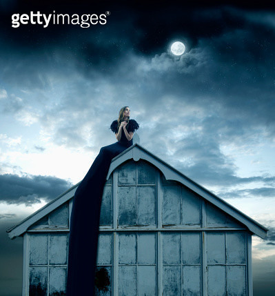Pacific Islander woman sitting on rooftop - gettyimageskorea