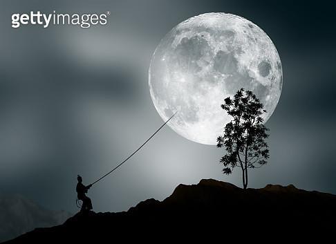 Man pretending to steal moon - gettyimageskorea