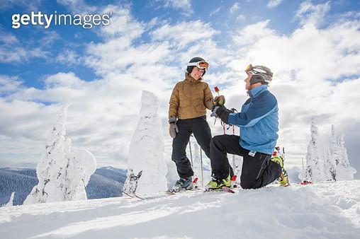 Romantic moment between skier couple - gettyimageskorea