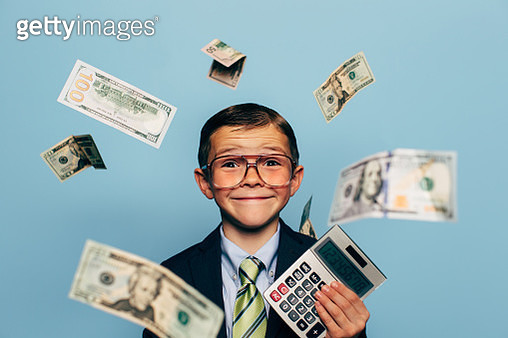 Young Boy Accountant Wearing Glasses holding Calculator - gettyimageskorea