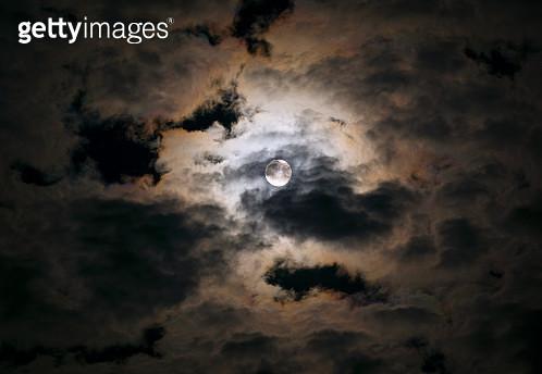 Full moon breaking through clouds - gettyimageskorea
