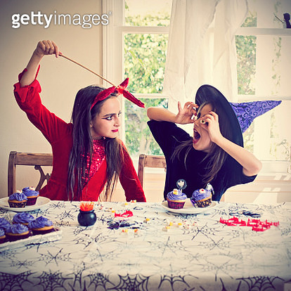 Two girls dressed up for Halloween playing - gettyimageskorea
