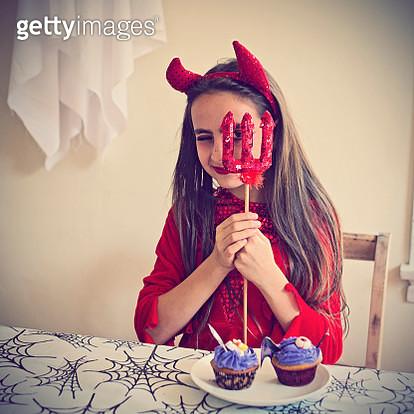Girl dressed in red Devil costume for Halloween - gettyimageskorea