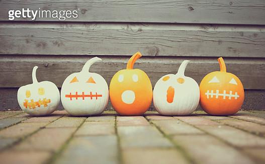 Row of scary pumpkins - gettyimageskorea