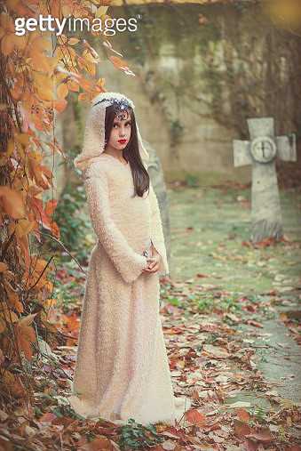 Portrait of a girl in halloween costume standing in a cemetery - gettyimageskorea