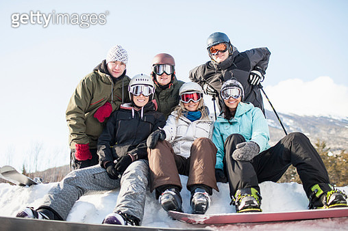 Portrait of friends while resting during skiing and snowboarding - gettyimageskorea