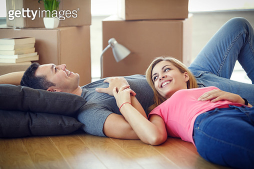 Young couple resting from moving into a new home - gettyimageskorea