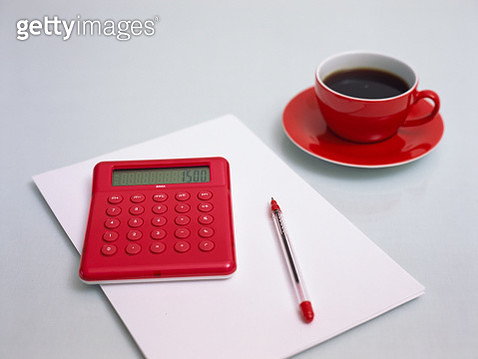 Pocket Calculator, Cup of Coffee, Biro and Sheet of Paper - gettyimageskorea