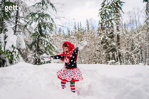 Girl messing around in the snow - gettyimageskorea