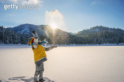 Boy throwing snow in the air - gettyimageskorea