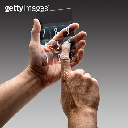 Two hands holding a calculator. - gettyimageskorea