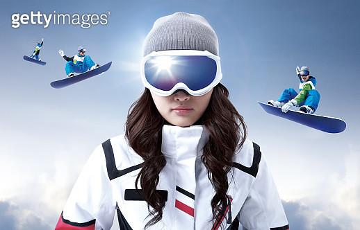 woman standing in background of men snowboarding - gettyimageskorea