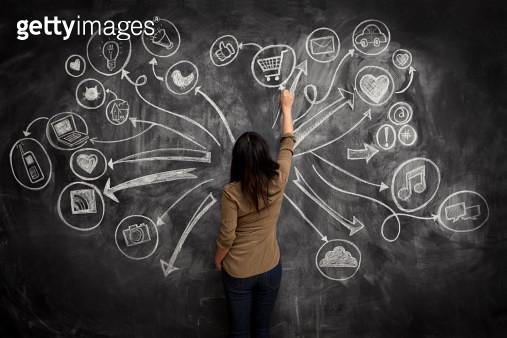 Girl drawing social meida icons on chalkboard - gettyimageskorea