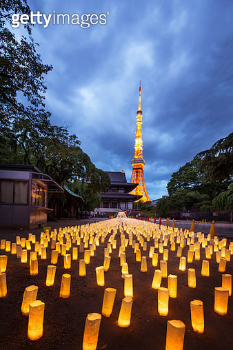 space with many illuminated candles near glowing tokyo tower - gettyimageskorea