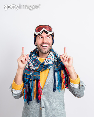 Happy handsome man in winter outfit pointing at copy space - gettyimageskorea