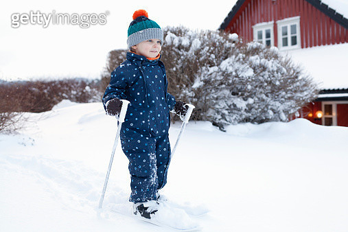 Boy learning to use his skis - gettyimageskorea