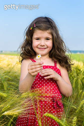 Smiling girl with the flower - gettyimageskorea