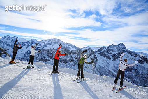 Skiing   Warm Up   Happy skier class on the mountain top - gettyimageskorea
