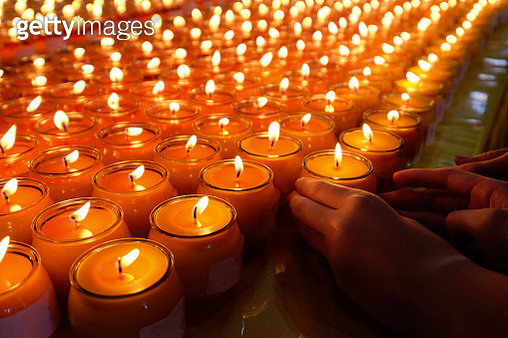 Butter lamps burning at a shrine - gettyimageskorea