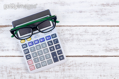 Directly Above Shot Of Eyeglasses And Calculator On White Table - gettyimageskorea