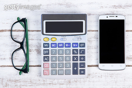 Directly Above Shot Of Calculator With Eyeglasses And Smart Phone On Table - gettyimageskorea