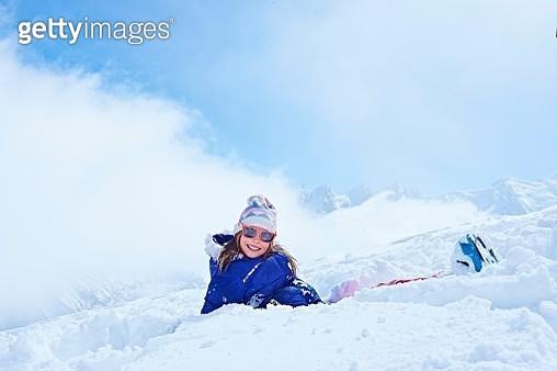 Girl sitting in snow, Chamonix, France - gettyimageskorea