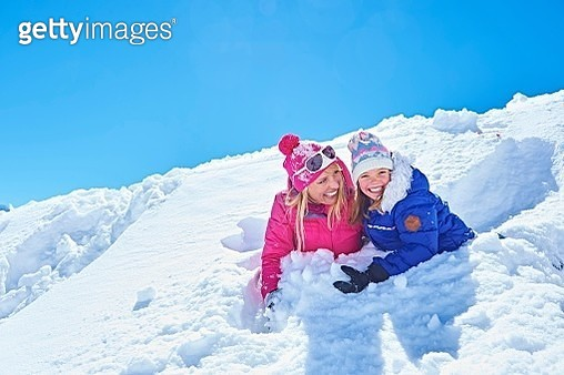 Mother and daughter playing in snow, Chamonix, France - gettyimageskorea