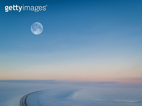 Moon over snowy road, Iceland - gettyimageskorea
