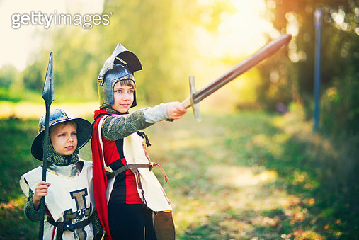 Kids dressed up as knights playing outdoors - gettyimageskorea