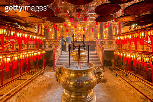 Unknown Asian prayers are praying inside the Man Mo temple - gettyimageskorea