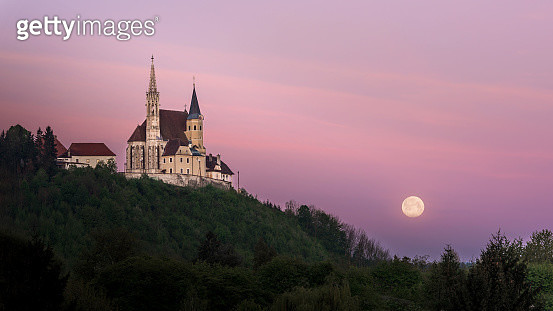 Pilgrimage Church Maria Straßengel - Full moon - purple - gettyimageskorea