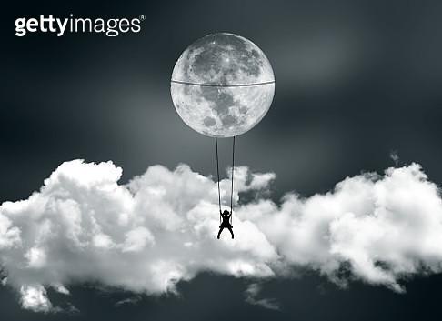 Girl swinging on the moon - gettyimageskorea
