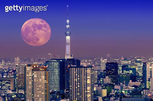Full moon rising over Tokyo - gettyimageskorea