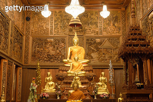 Golden Buddha Statue in Buddhist temple - gettyimageskorea