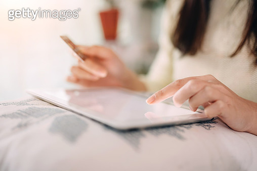 Woman doing online shopping with digital tablet - gettyimageskorea