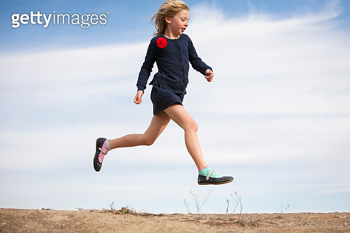 Young girl leaping through the air - gettyimageskorea